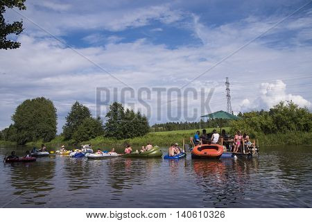 HELSINKI, FINLAND - JULY 30: Unidentified people drafting down Vantaanjoki river on rubber dinghies, rafts and other inflatables at the annual Kaljakellunta (Beer Floating) festival taking place at the end of the July or beginning of the August. Festival