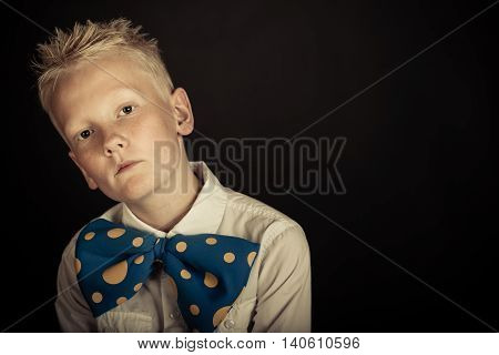 Cute Boy In Big Blue Bowtie With Copy Space