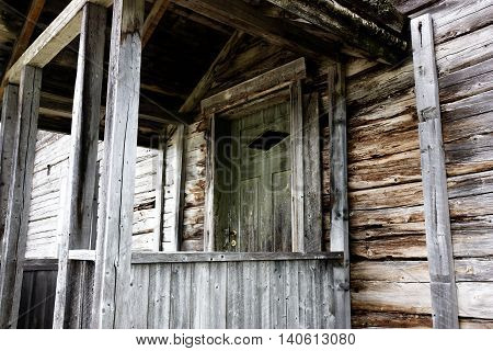 Door and entrace to old wooden hut