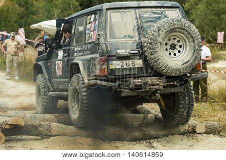Lviv Ukraine - August 23 2015: Off-road vehicle brand Nissan overcomes the obstacle on of sandy career near the city Lviv Ukraine.