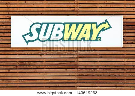 Neronde,  France - June 23, 2016: Subway logo on a facade. Subway is an American fast food restaurant franchise that primarily sells submarine sandwiches and salads