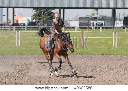 Kiev Ukraine - June 09 2016: Girl on a horse training in show jumping