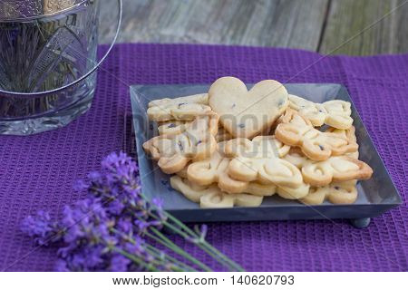 Butterflies Butter Biscuits Cookies and Heart Biscuits with Lavender on Sheet tray on violet cloth