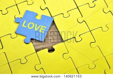 Puzzle pieces with word Love