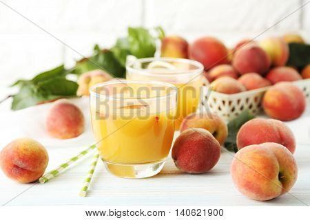 Glasses Of Peach Juice On White Wooden Table