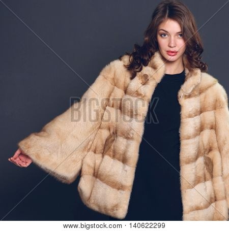 Portrait of a beautiful woman in a jacket with fur