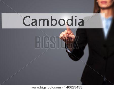 Cambodia - Businesswoman Pressing High Tech  Modern Button On A Virtual Background