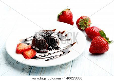 Chocolate Fondant With Strawberry On Blue Wooden Table