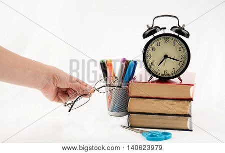 Study time preparations with glasses in women hand
