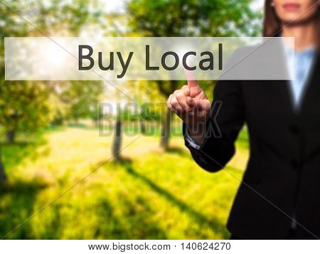 Buy Local - Businesswoman Pressing High Tech  Modern Button On A Virtual Background