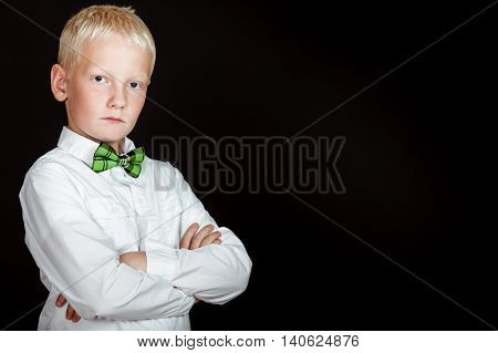 Boy In White Shirt And Green Checkered Bow Tie