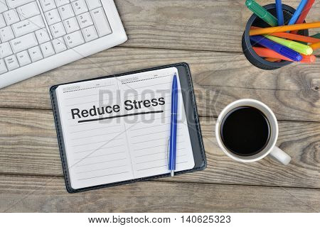 Reduce Stress message on notebook and coffee