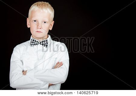 Serious Boy With Arms Crossed Wearing Bow Tie