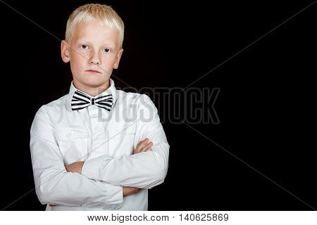 Blond Boy With Bad Attitude Stares At Camera
