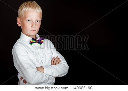 Blond Boy In White Shirt And Rainbow Bow Tie