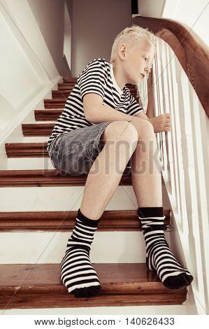 Blond Boy Wearing Stripped Shirt And Socks