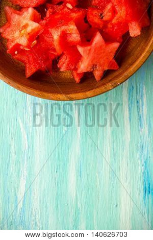 Healthy watermelon smoothie on a wood background and slices. Watermelon slice popsicles on a vintage blue rustic wood background. yummy fresh summer fruit sweet dessert. Bunch of sliced