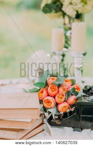 Old typewriter vintage ornaments and vases of dried flowers on wedding table