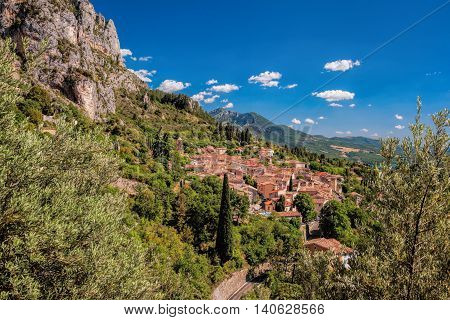 Moustiers Sainte Marie Village With Rocks In Provence, France