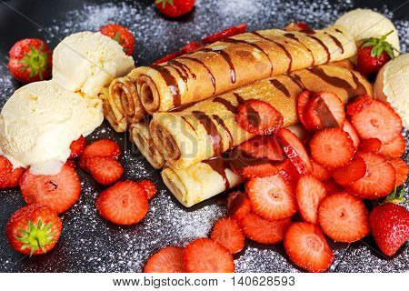 Sweet Rolled Pancakes with nutella, strawberry and ice cream