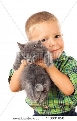 Little boy holding a gray kitten, isolated on white
