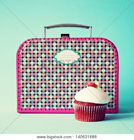 Vintage lunchbox and a red strawberry cupcake