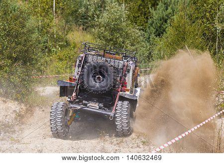 lLviv Ukraine - August 23 2015: Upgraded off-road vehicle overcomes the track on of sandy career near the city Lviv Ukraine.