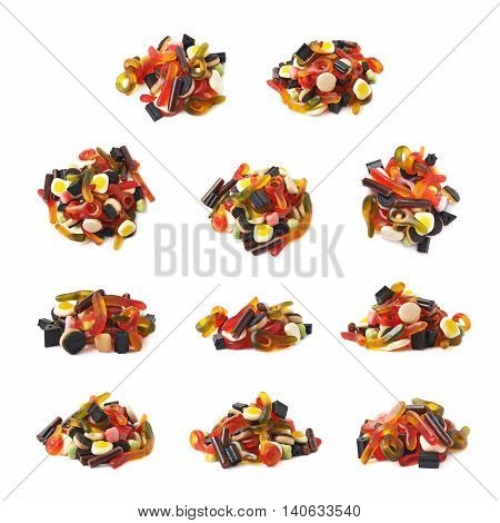 Pile of multiple colorful gelatin and licorice based candies isolated over the white background, set of multiple different foreshortenings