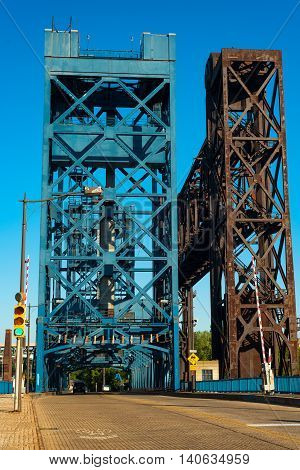 The Carter Road lift bridge with a railroad lift bridge next to it on the right spanning the Cuyahoga River in Cleveland Ohio