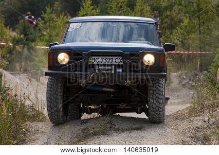 Lviv Ukraine - August 23 2015: Off-road vehicle brand Land Rover overcomes the track on of sandy career near the city Lviv Ukraine.