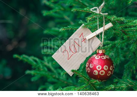 Great Red Christmas Ball Hanging On A Branch Green Pine