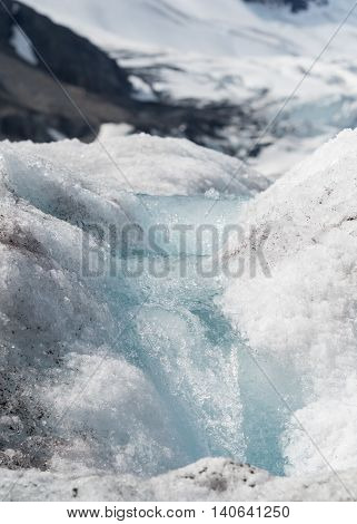 Small Glacial Melt Waterfall on Ice flows during summer