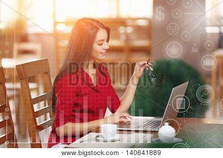 Businesswoman Working On Laptop In Coffee Shop. Young business woman uses laptop in cafe. Businesswoman working typing in a laptop. Business infographic