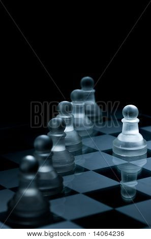 Macro Shot Of Glass Chess Pieces Against A Black Background