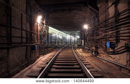 Passing train in the underground subway tunnel