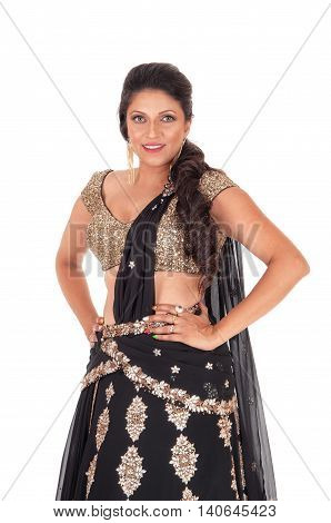 A gorgeous young woman standing in a gold color top and black skirt halve length isolated for white background.