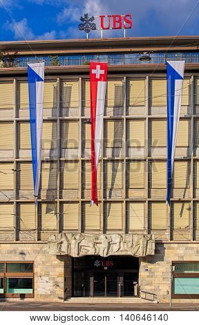 Zurich, Switzerland - 30 July, 2016: facade of the UBS building on Paradeplatz square decorated with flags of Switzerland and Zurich. UBS AG is a Swiss global financial services company incorporated in the Canton of Zurich.