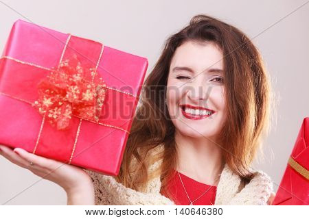 Woman Holding Two Gifts.
