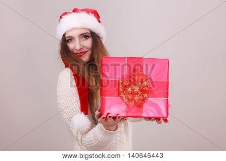 Happy Girl Holding Gift.