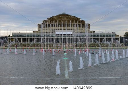 Wroclaw, Poland, July 19, 2016: The Multimedia Fountain (Water, Light, Music) in front of the Centennial Hall in Wroclaw, Poland.