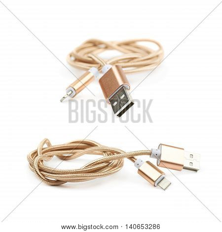 Folded USB lightning golden cable isolated over the white background, set of two different foreshortenings