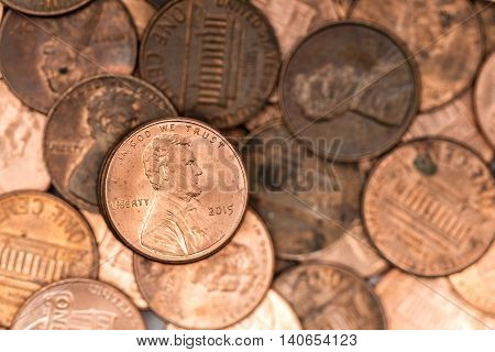 A bunch of pennies, but only one on focus