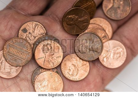 A lot of pennies on a hand