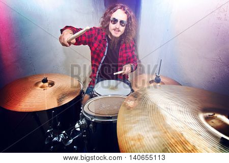 Drums conceptual image. Rock drummer playing on drums. Retro vintage instagram picture.