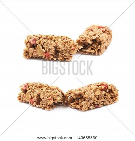Broken in two parts nutrient chewy grains bar isolated over the white background, set of two foreshortenings