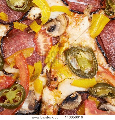 Close-up fragment of a mexican pizza isolated over the white background