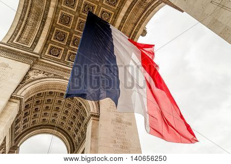 Arc de Triomphe with french flag hanging below