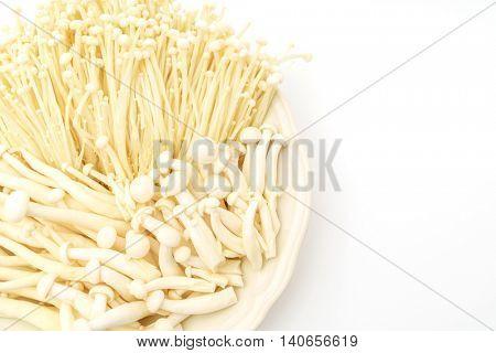 Enoki mushroom and beech mushrooms on the White background