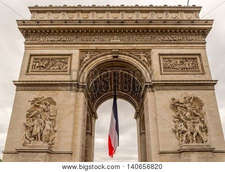 Arc de Triomphe with french flag hanging limp below