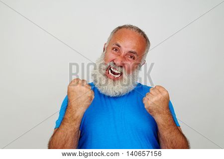 Aged man with white beard is gesturing nervousness isolated on white